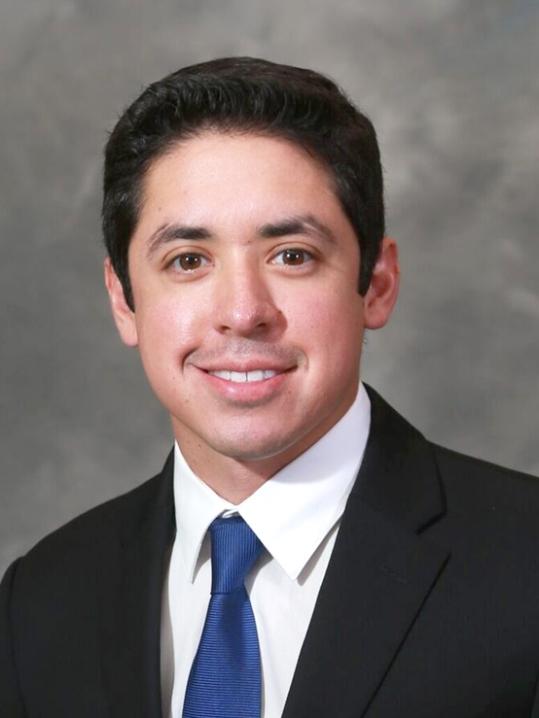 Dr. Austin De La Cruz